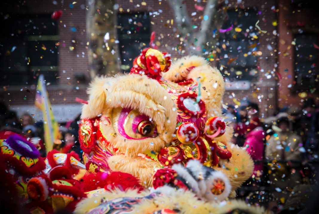 Lion dance and confetti during Chinese New Year celebration (Shutterstock)