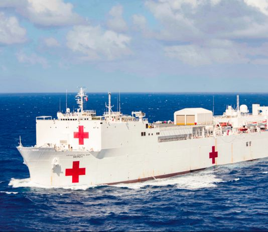 Ship with large painted red crosses on ocean (U.S. Navy/Petty Officer 2nd Class Kelsey L. Adams)