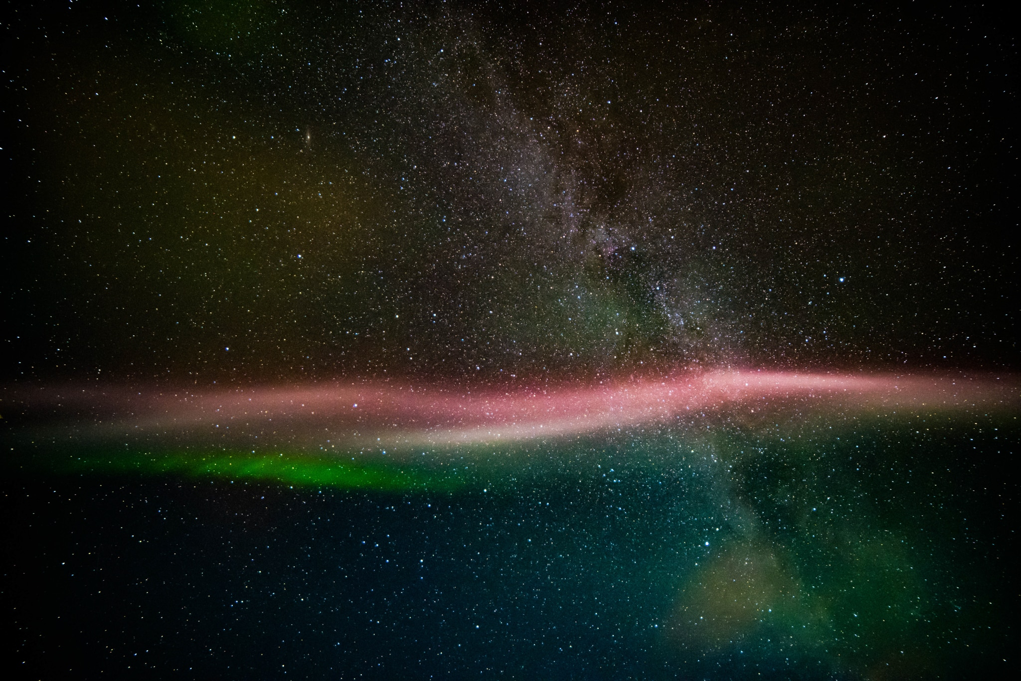 Red and green streaks in night sky (Courtesy of Megan Hoffman/NASA)