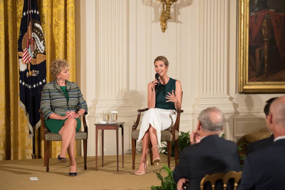 Two women seated, talking to an audience (Official White House photo by Andrea Hanks)