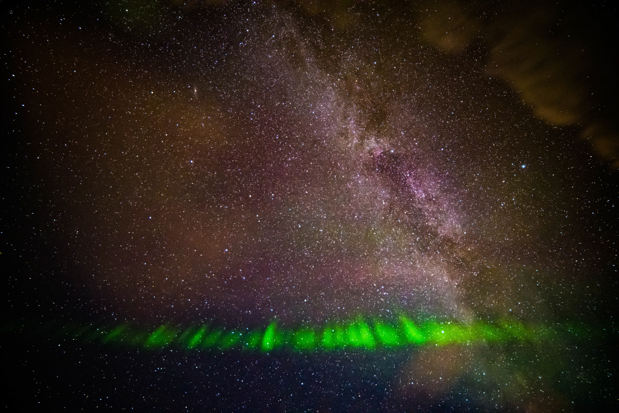 Green streaks and purple light in night sky (Courtesy of Megan Hoffman/NASA)