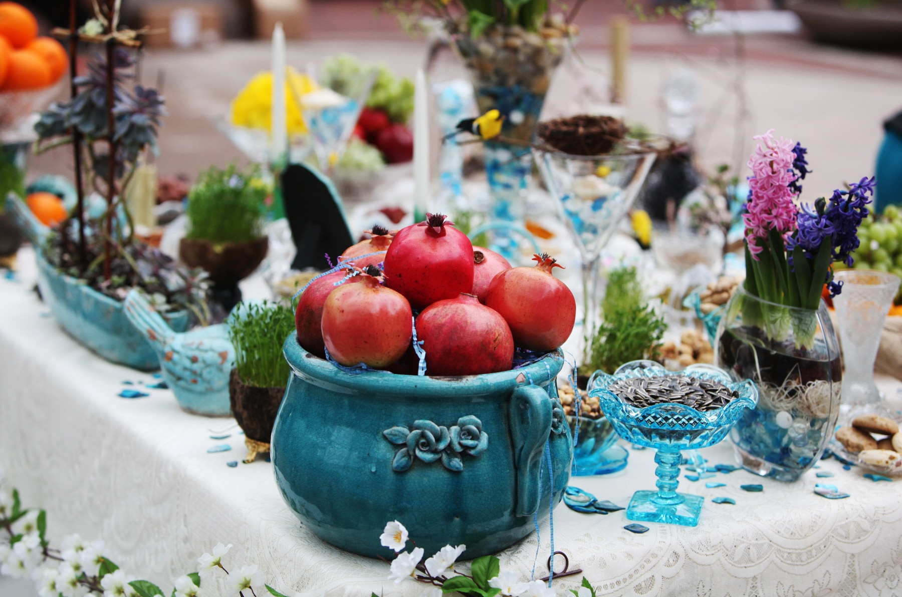 Table full of offerings for a religious holiday (©Ali Khaligh)