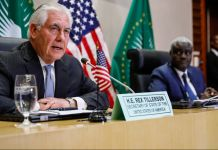 Rex Tillerson and Moussa Faki seated at table (© Jonathan Ernst/AP Images)