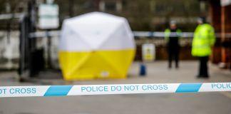 Police tape in front of scene (© Matt Dunham/AP Images)