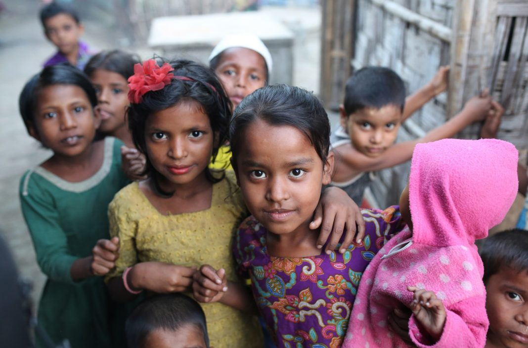 Children standing in a street looking at the camera (© Zakir Hossain Chowdhury/Anadolu Agency/Getty Images)