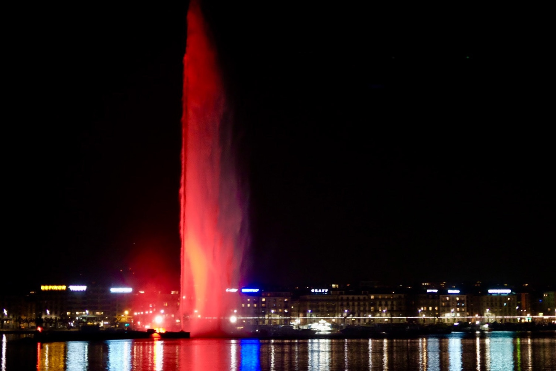 Red water spouting up from a lake against a black night sky (Stop TB Partnership)