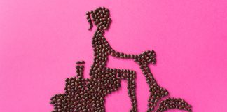 Coffee beans arranged to form woman riding motor scooter (© City Girl Coffee)
