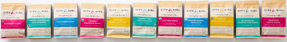 Row of bags of coffee (© City Girl Coffee Company)