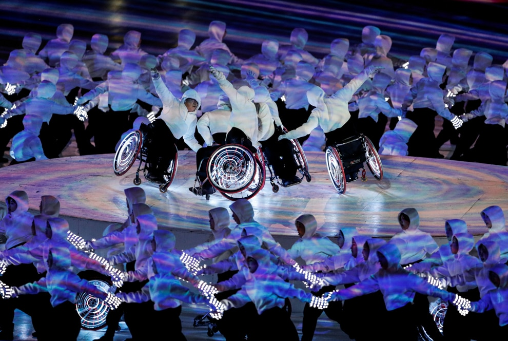 Performers in wheelchairs surrounded by other performers (© Paul Hanna/Reuters)