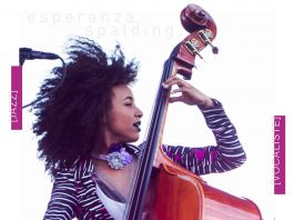 Esperanza Spalding standing with a bass, with explanatory text underneath (State Dept./D. Woolverton. Photo: AP Images)