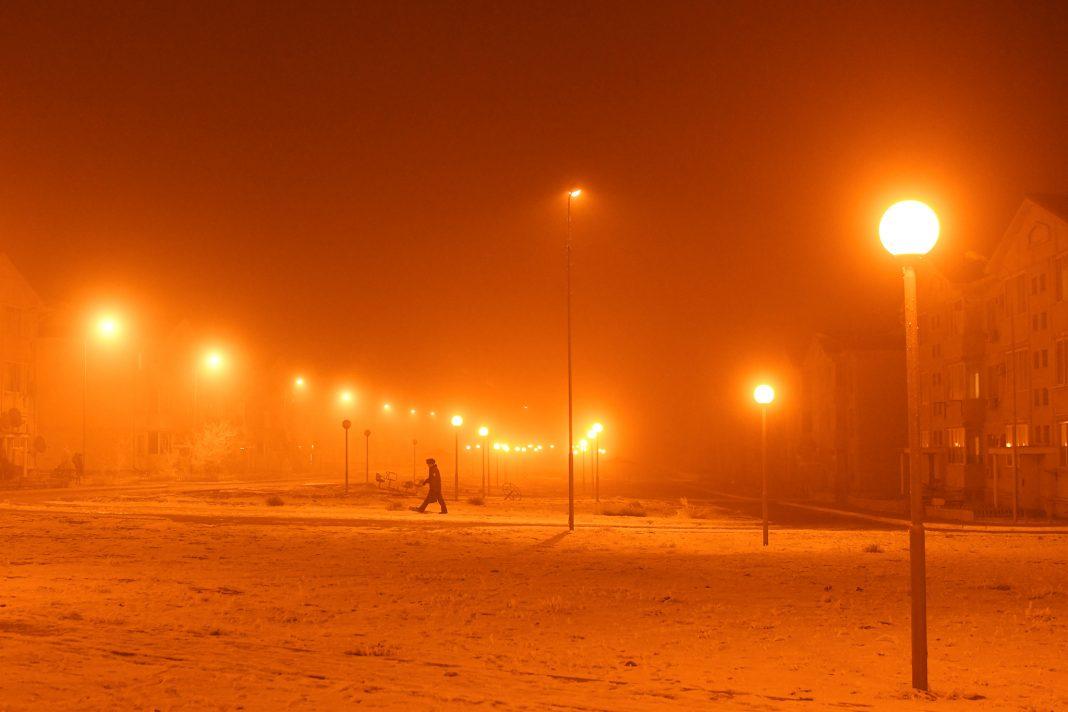 Orange lights illuminating landscape (© Andrea Bruce/New York Times/Redux)