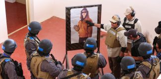 An instructor speaks to law enforcement officers at a new training academy near Amman, Jordan. (© Raad Adayleh/AP Images)