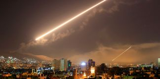 Missile streaking through sky (© Hassan Ammar/AP Images)