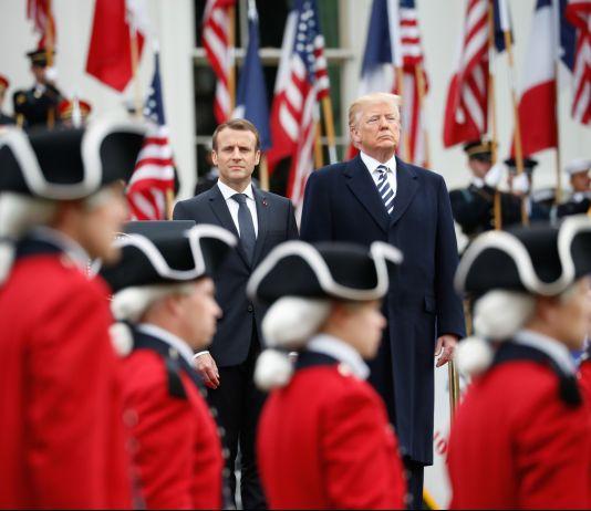 Macron and Trump walking past military guard (© Pablo Martinez Monsivais/AP Images)