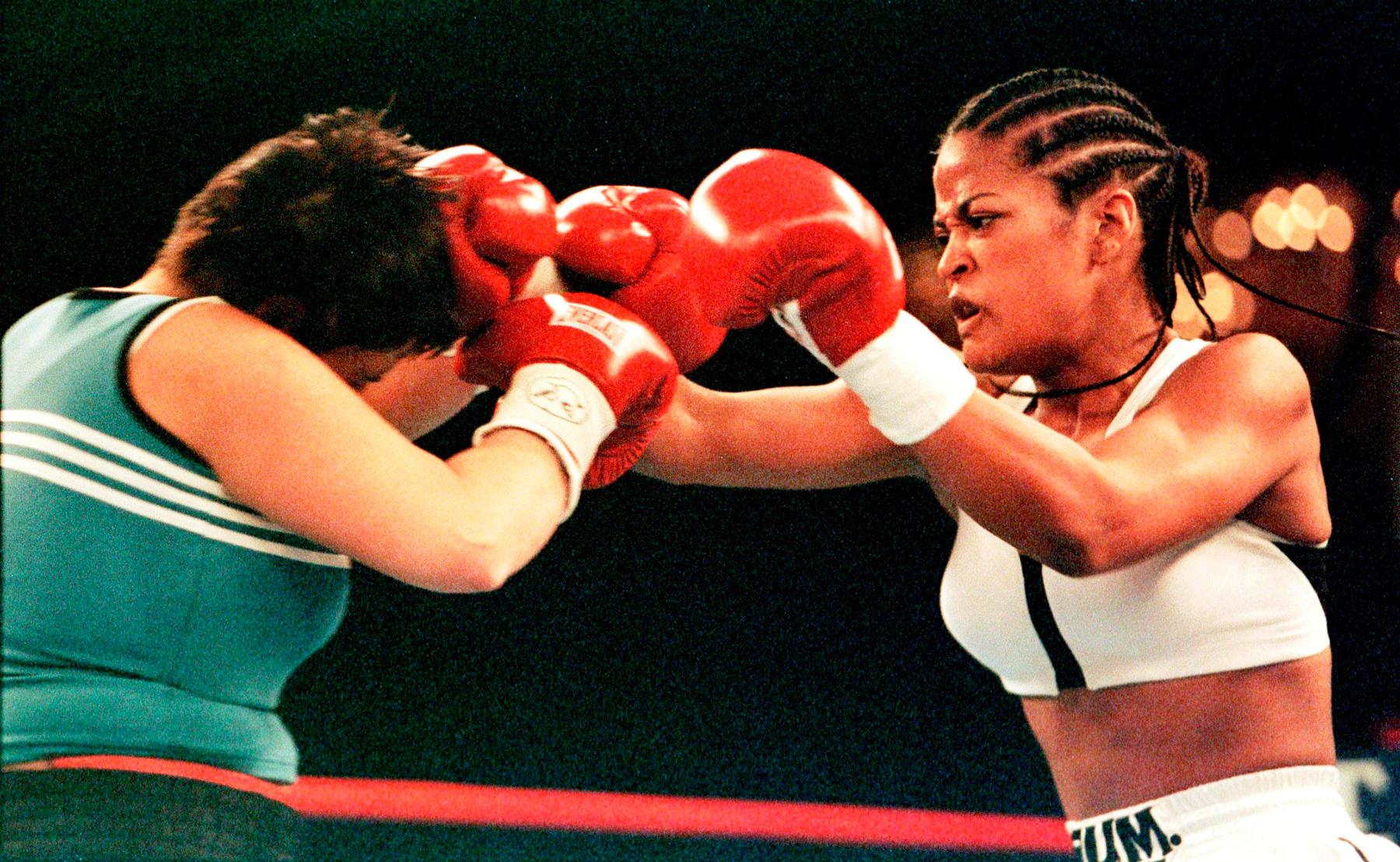 Two women boxing (© Michael Okoniewski/Liaison Agency/Getty Images)