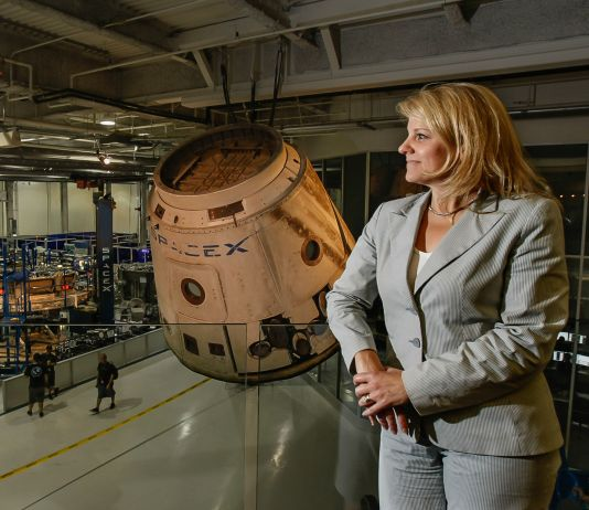 Woman standing in front of space capsule (© Gary Friedman/Los Angeles Times/Getty Images)