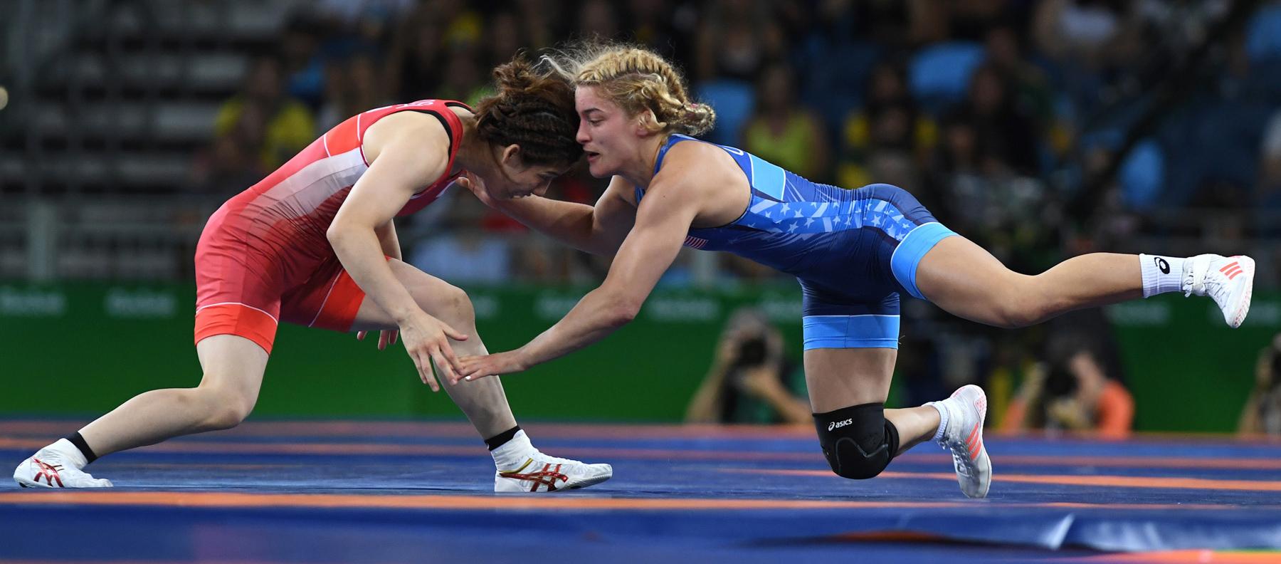 Two women wrestling on mat (© Mark Reis/Colorado Springs Gazette/TNS/Getty Images)