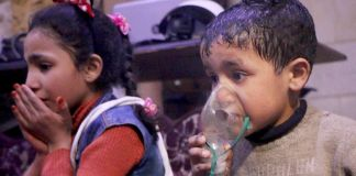 Girl with hands to her mouth and boy holding oxygen mask to his face (© Syrian Civil Defense/Anadolu Agency/Getty Images)