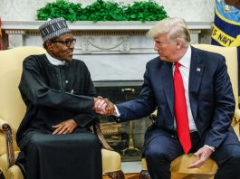 Muhammadu Buhari and President Trump seated and shaking hands (© Kevin Lamarque/Reuters)