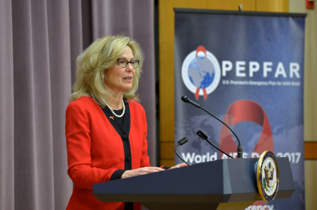 Woman talking at lectern (State Dept.)