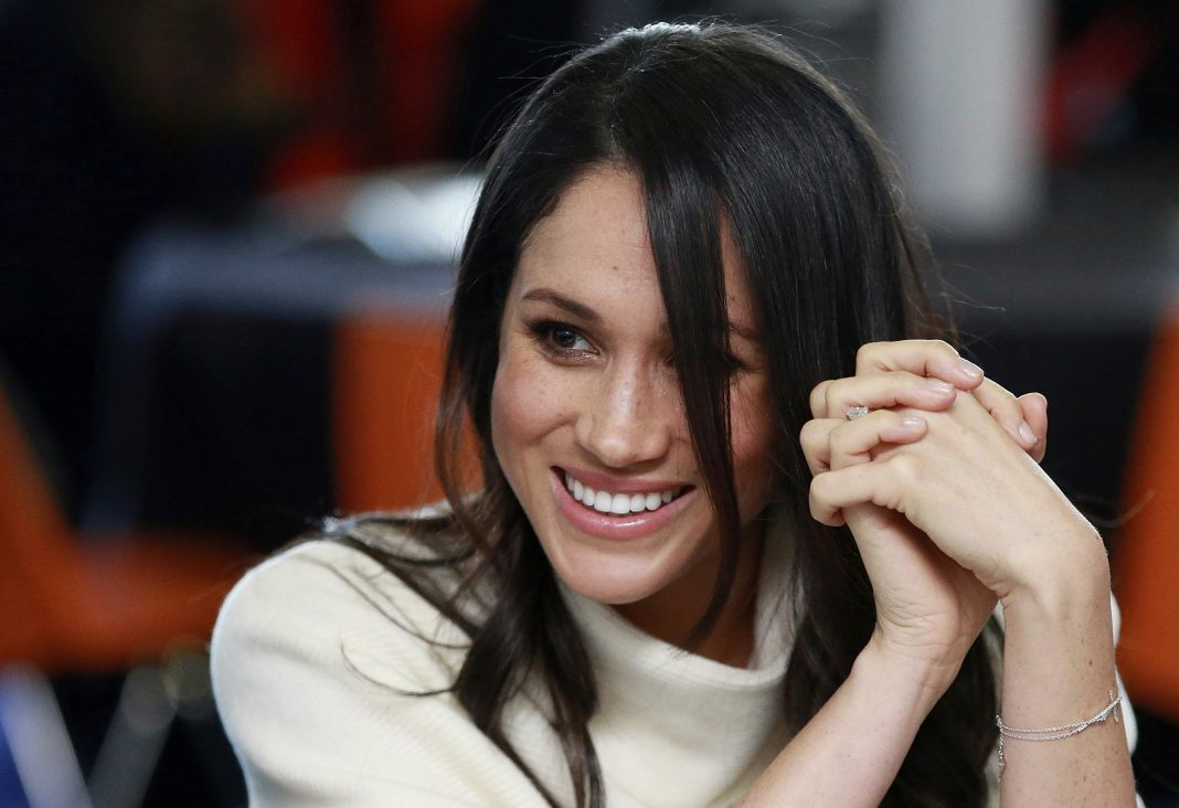 Meghan Markle sonriendo (© Ian Vogler/AP Images)