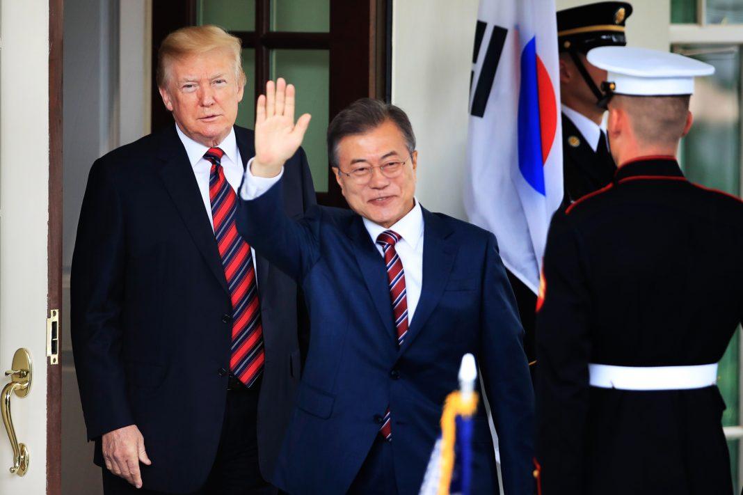 President Trump and Moon Jae-in with guard (© Manuel Balce Ceneta/AP Images)