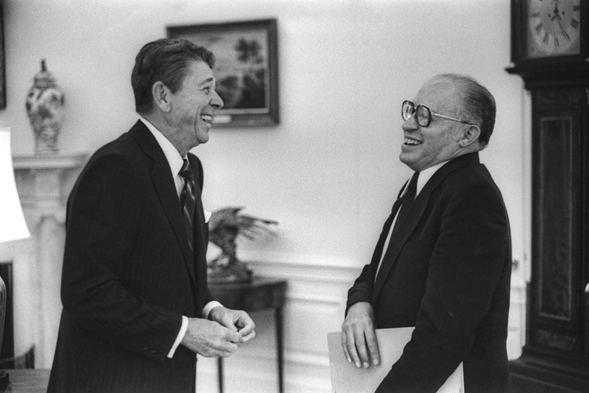 President Reagan laughing with a man (State Dept.)