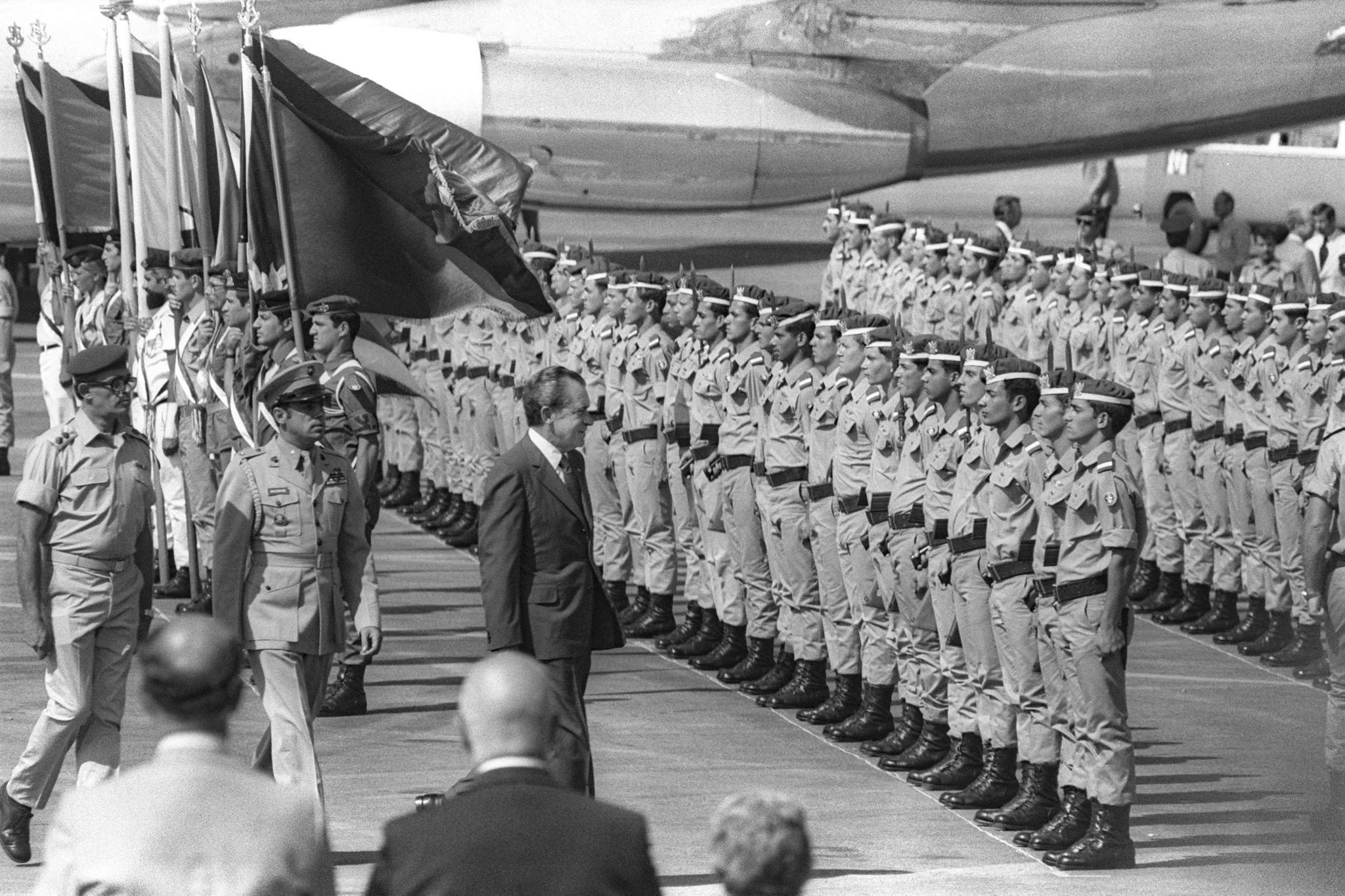 President Nixon walking past uniformed troops (State Dept.)