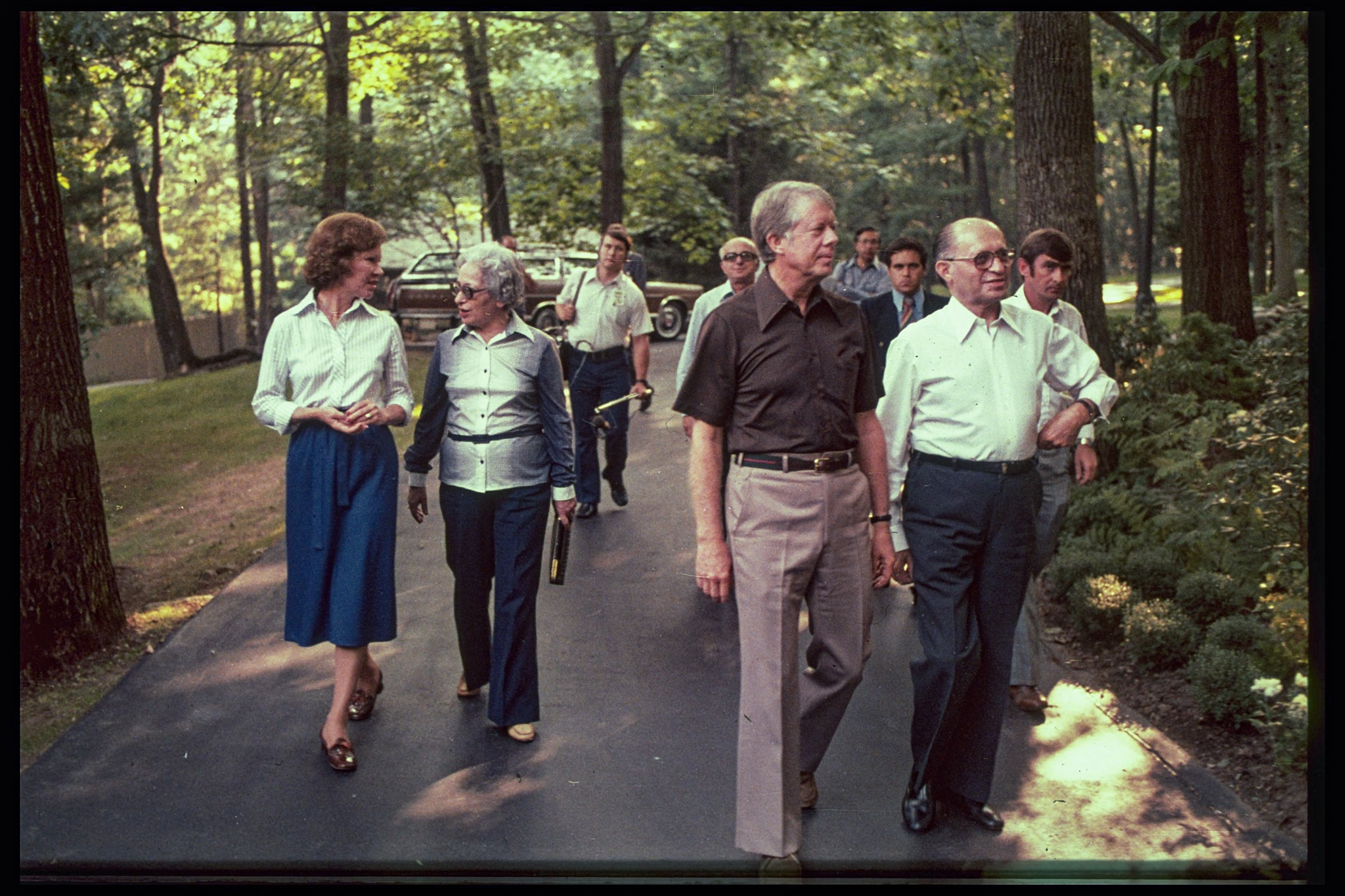 President Carter and others walking on wooded path (State Dept.)