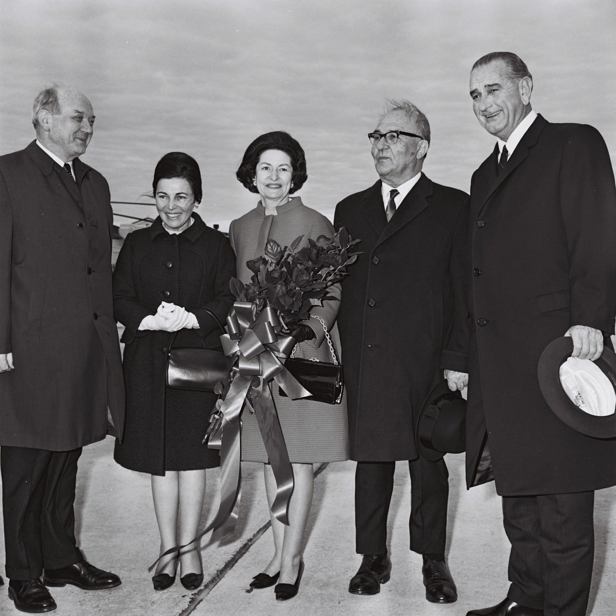 Two women standing flanked by three men (State Dept.)
