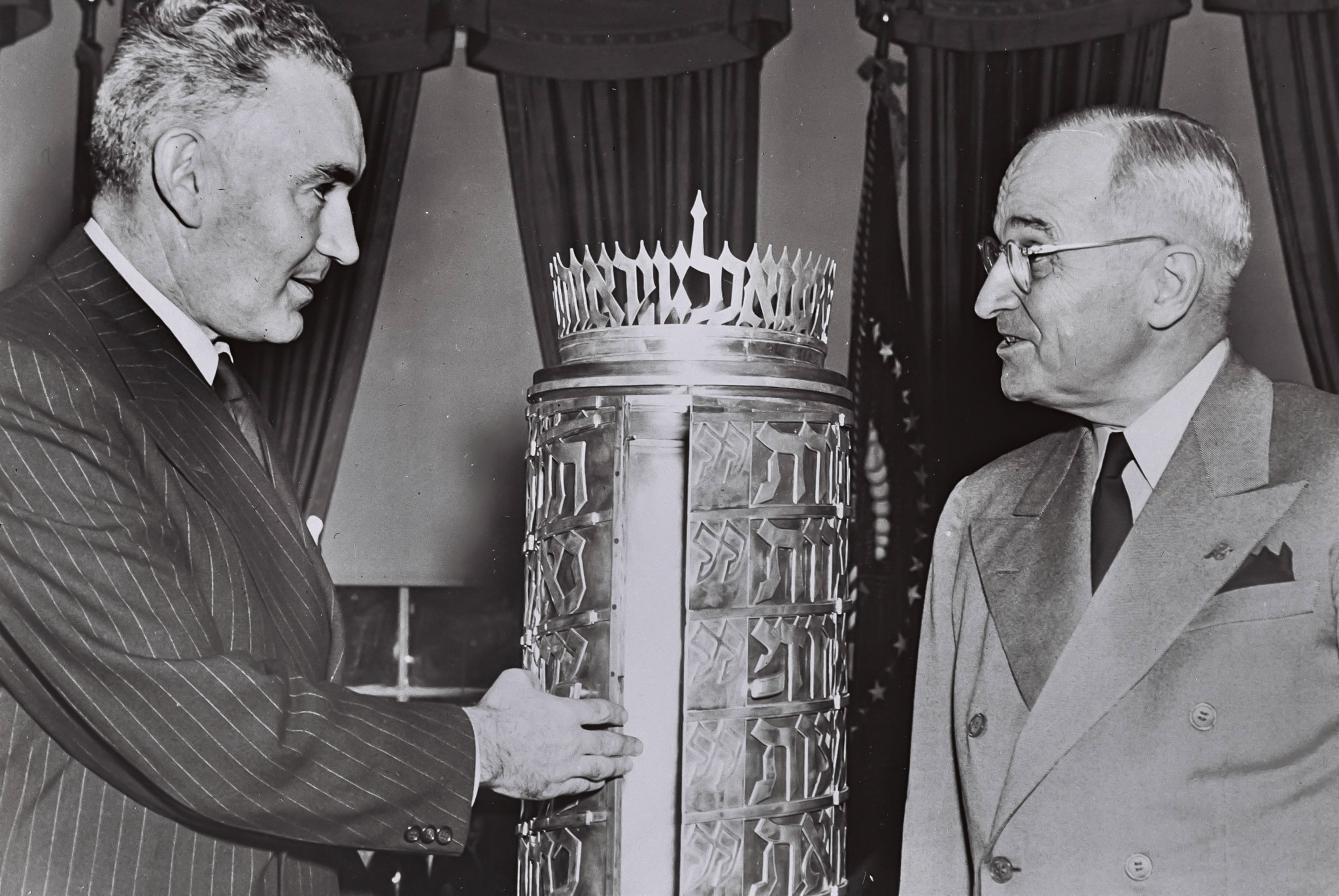 Man talking to President Truman while pointing to ark (State Dept.)