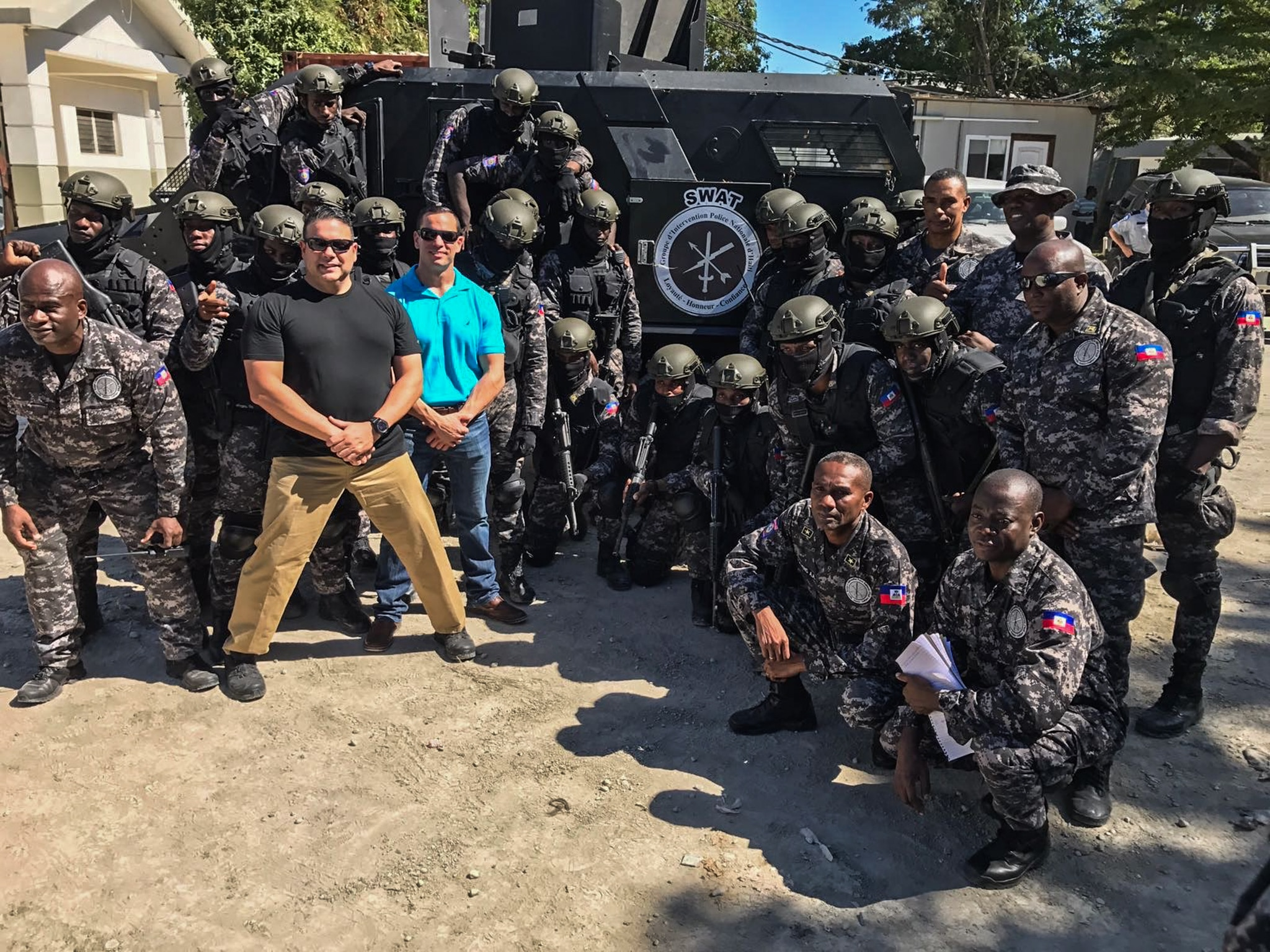 Uniformed people posing in a group (© Sergeant Oscar D. Pla, Miami-Dade Police Department)