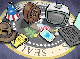 Reporter's notebook and hat, megaphone, radio, TV, laptop and phone on presidential seal (State Dept./Doug Thompson)