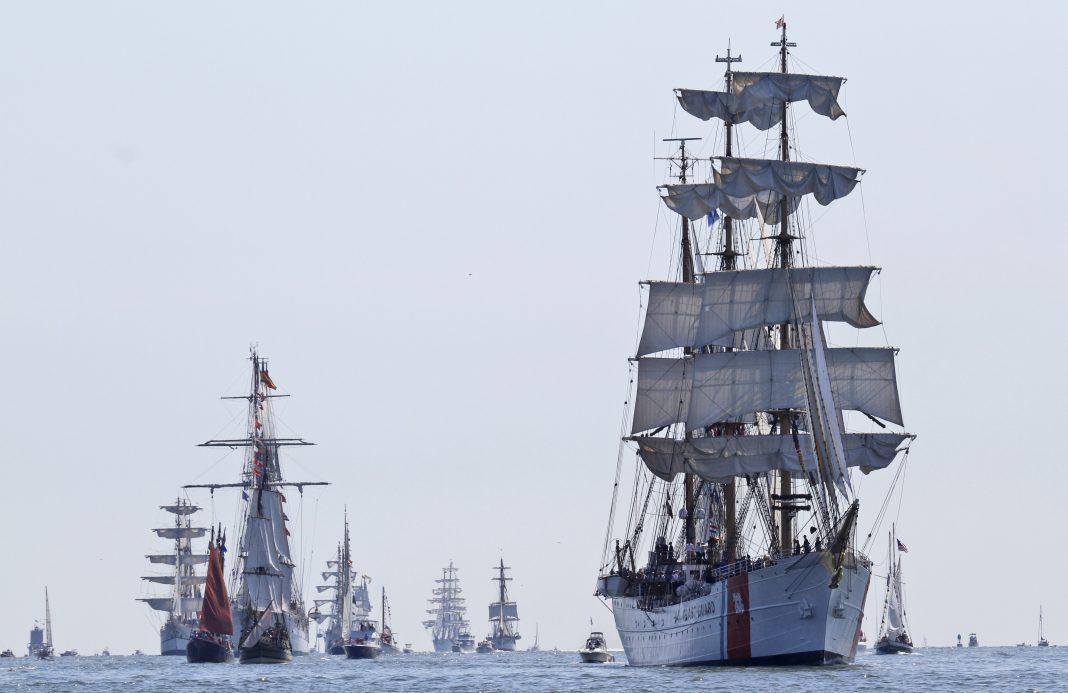 Sailing ships at sea (© Steve Helber/AP Images)