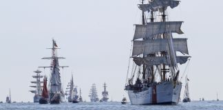 Sailing ships at sea (© Steve Helber/AP Images)