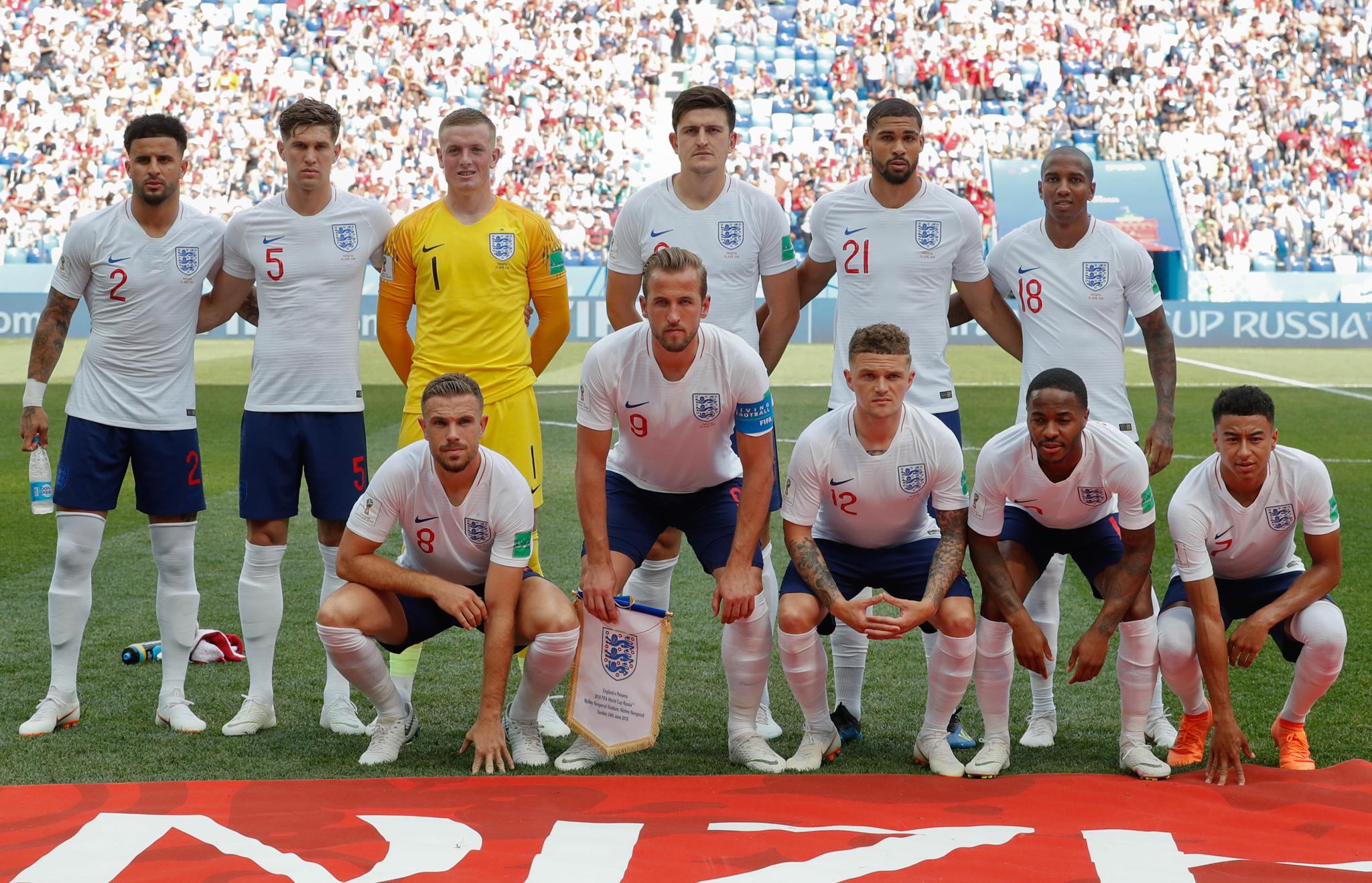 Des joueurs de foot posant pour une photo de groupe (© Antonio Calanni/AP Images)