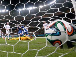 Soccer ball hitting net during soccer match (© Matt Dunham/AP Images)