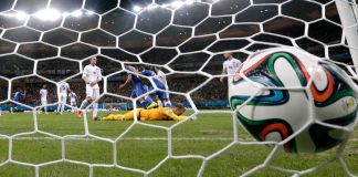 Soccer ball hitting net during soccer match (© Matt Dunham/AP Images)