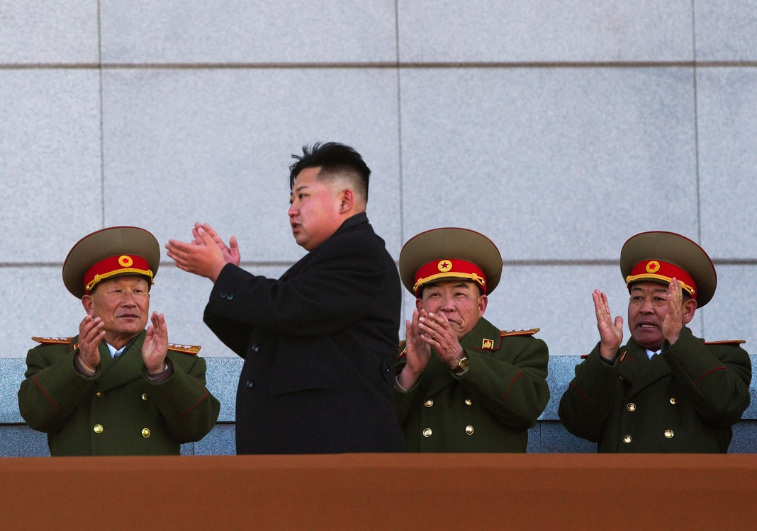 Kim Jong Un clapping, soldiers behind him (© David Guttenfelder/AP Images)