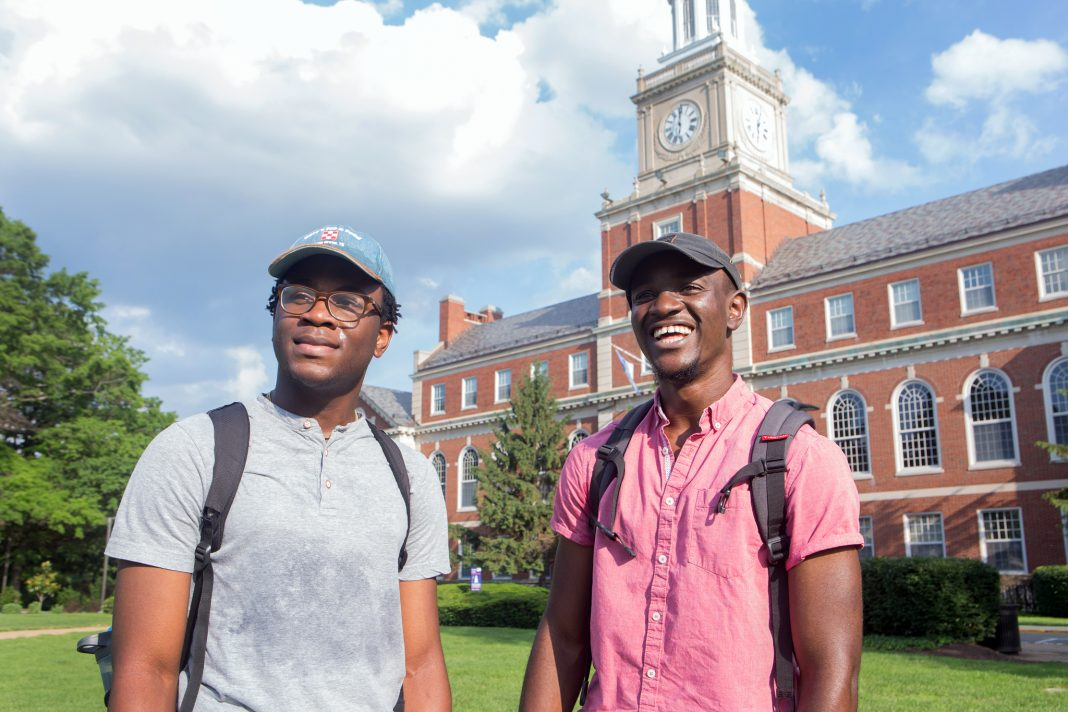 Two young men standing on a college campus (State Dept./D.A. Peterson)