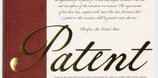 Two-color cover with 'Patent' written in gold lettering, statement from USPTO director and gold seal (USPTO)