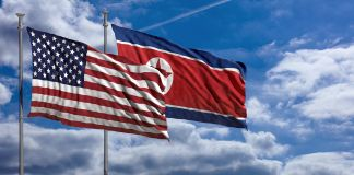 U.S. and North Korean flags waving in wind (© Shutterstock)