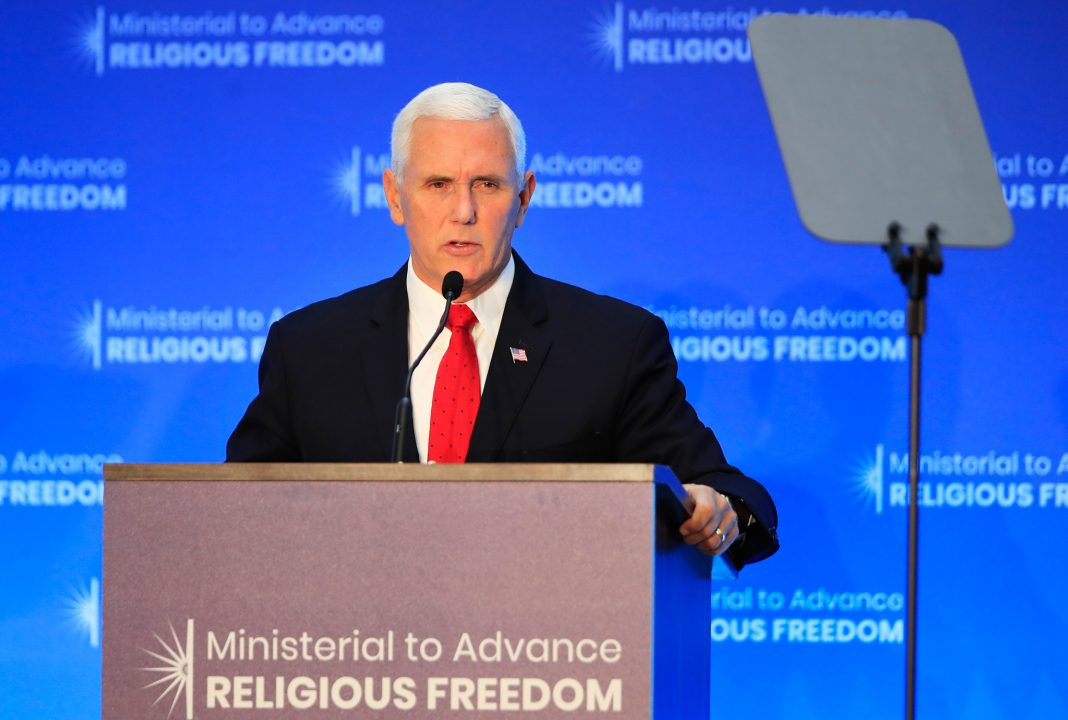 Mike Pence speaking at a lectern (@ Manuel Balce Ceneta/AP Images)