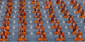 People wearing orange seated in rows (© Sakchai Lalit/AP Images)