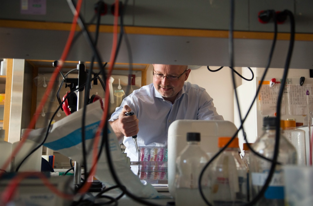 Man working in a medical lab (© Shawn Rocco/Duke Health)