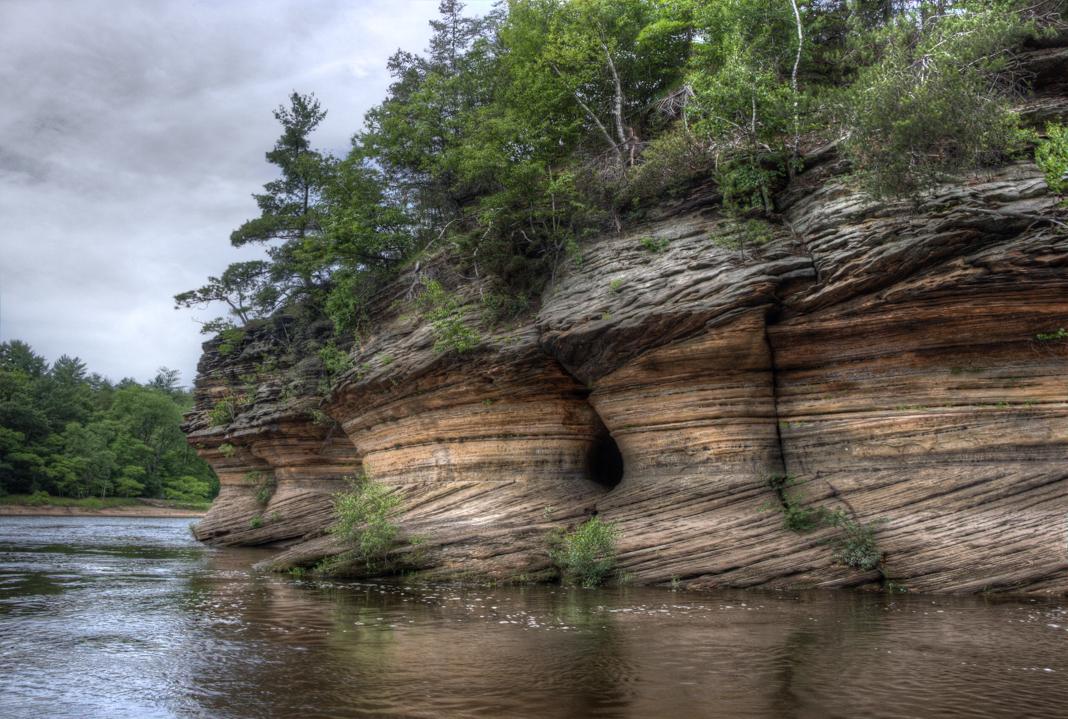 Rock formations next to river (© Jacob Boomsma/Alamy)