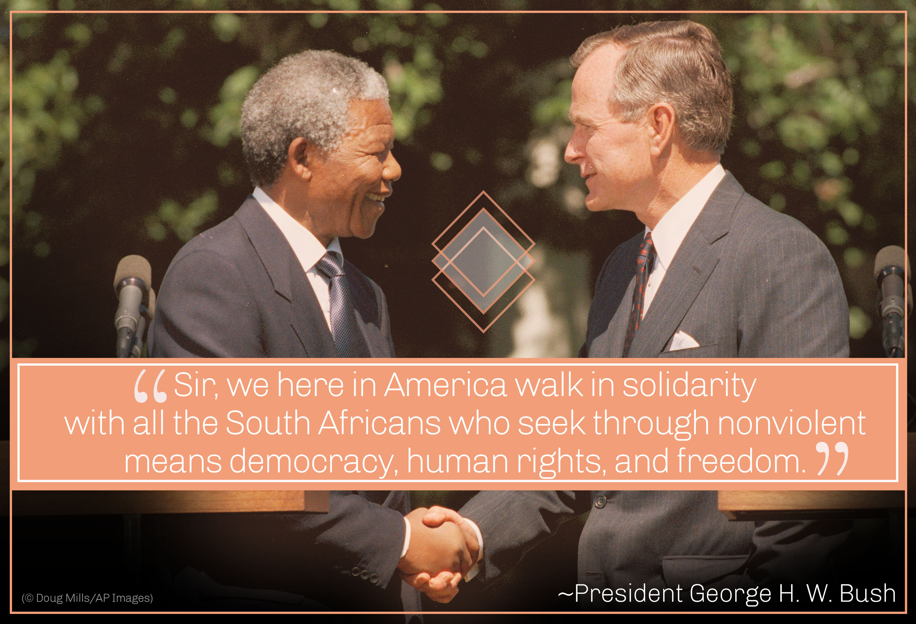Photo of Mandela and President George H.W. Bush shaking hands, Bush quote about walking in solidarity (© Doug Mills/AP Images)