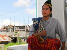 Young man in traditional Philippine garb (USAID)