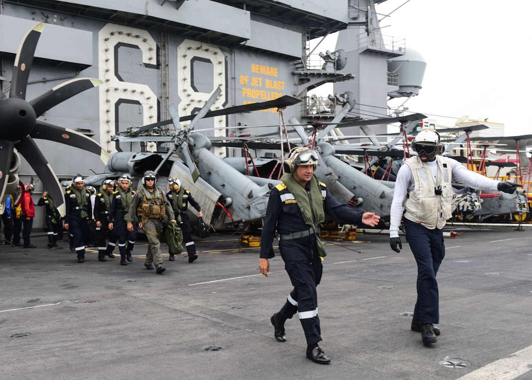 Sailors walking near helicopters on ship deck (DOD/U.S. Navy Petty Officer 2nd Class Holly L. Herline)