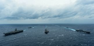 Military ships sailing in formation (DOD/U.S. Navy Petty Officer 3rd Class Leon Wong)